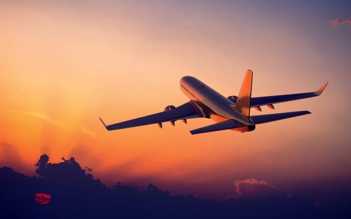 7014902-airplane-flight-sunset